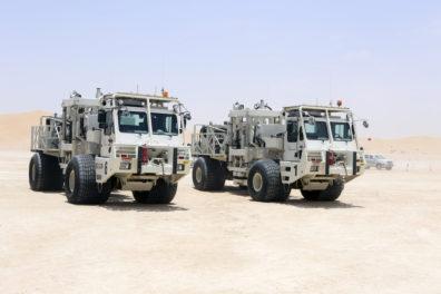 OMV seismic trucks in the desert in Abu Dhabi