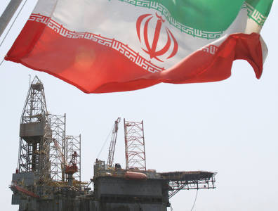 Iran flag flying over oil rig