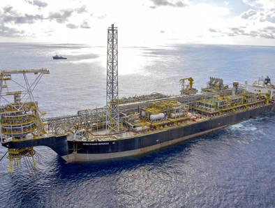 Oil down on stronger dollar, weak US economic data