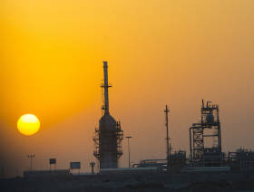 Oil down, but set to record third weekly gains